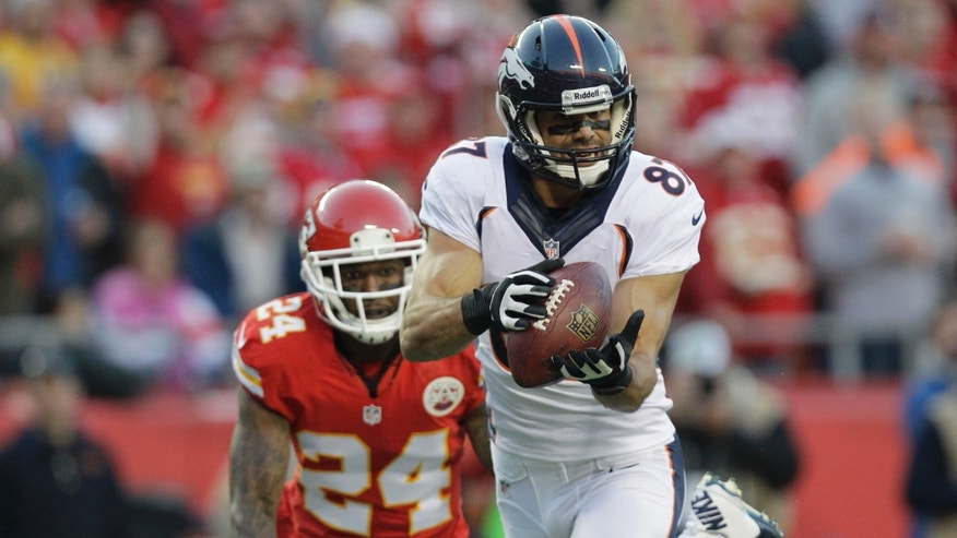 Denver Broncos wide receiver Eric Decker (87) makes a touchdown reception against Kansas City Chiefs cornerback Brandon Flowers (24) during the first half of an NFL football game, Sunday, Dec. 1, 2013, in Kansas City, Mo. (AP Photo/Ed Zurga)
