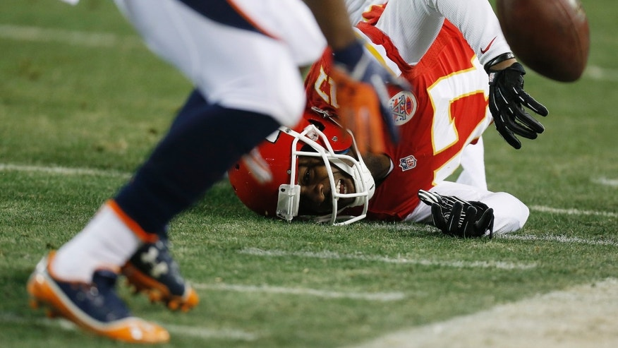 Kansas City Chiefs wide receiver Donnie Avery (17) falls to the ground as he misses a catch during the second half of an NFL football game against the Denver Broncos, Sunday, Dec. 1, 2013, in Kansas City, Mo. (AP Photo/Ed Zurga)