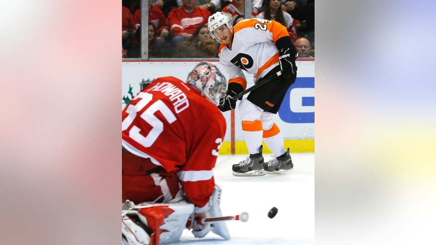 Philadelphia Flyers right wing Matt Read (24) watches his shot stopped by Detroit Red Wings goalie Jimmy Howard (35) in the first period of an NHL hockey game in Detroit, Wednesday, Dec. 4, 2013. (AP Photo/Paul Sancya)