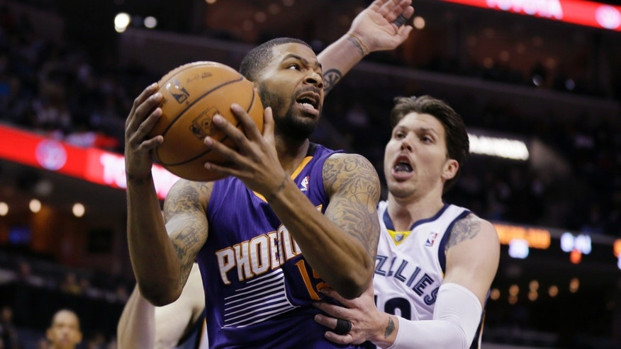 Phoenix Suns' Marcus Morris, left, gets an offensive rebound in front of Memphis Grizzlies' Mike Miller in the first half of an NBA basketball game in Memphis, Tenn., Tuesday, Dec. 3, 2013. (AP Photo/Danny Johnston)