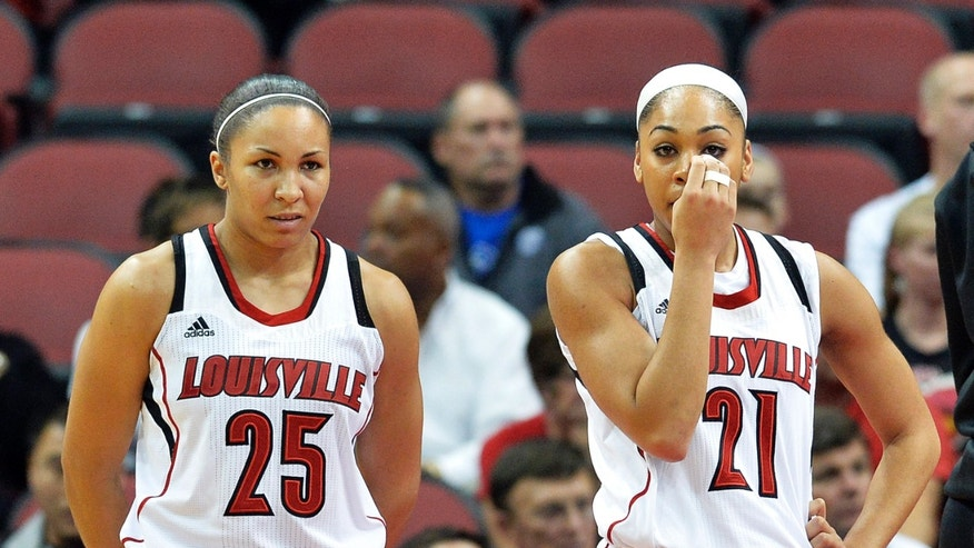 Louisville's Bria Smith, right, and Tia Gibbs stand following the collapse of teammate Antonita Slaughter during the first half of an NCAA college basketball game against Missouri State, Tuesday Dec. 3, 2013, in Louisville, Ky. (AP Photo/Timothy D. Easley)