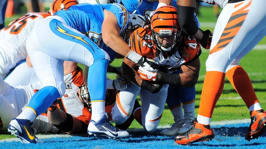 Cincinnati Bengals running back BenJarvus Green-Ellis (42) scores a touchdown against the San Diego Chargers during the first half of an NFL football game Sunday, Dec. 1, 2013, in San Diego. (AP Photo/Denis Poroy)