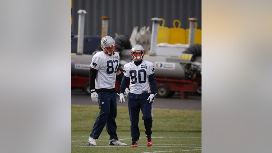 New England Patriots wide receiver Danny Amendola (80)  tight end Rob Gronkowski (87) pause during a drills and stretching session before practice begins at the NFL football team's facility in Foxborough, Mass., Wednesday, Dec. 4, 2013. The Patriots will face the Cleveland Browns on Sunday in Foxborough. (AP Photo/Stephan Savoia)