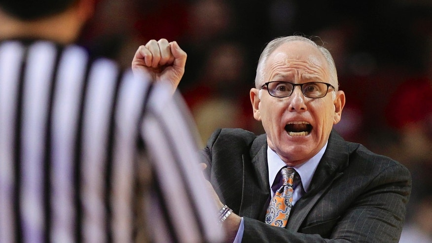 Miami coach Jim Larranaga calls for a foul to be called against Nebraska in the first half of an NCAA college basketball game  in Lincoln, Neb., Wednesday, Dec. 4, 2013. (AP Photo/Nati Harnik)