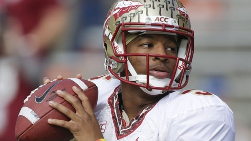 FILE - In this Nov. 30, 2013, file photo, Florida State quarterback Jameis Winston warms up before an NCAA college football game against Florida in Gainesville, Fla. (AP)