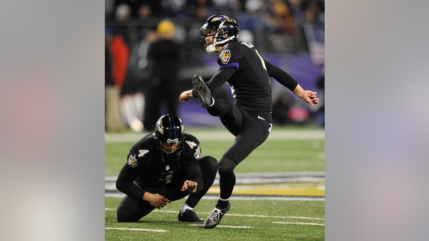 Baltimore Ravens' Justin Tucker (9) watches a successful field goal attempt alongside teammate Sam Koch in the second half of an NFL football game against the Pittsburgh Steelers, Thursday, Nov. 28, 2013, in Baltimore. Tucker contributed five field goals to Baltimore's 22-20 win. (AP Photo/Nick Wass)