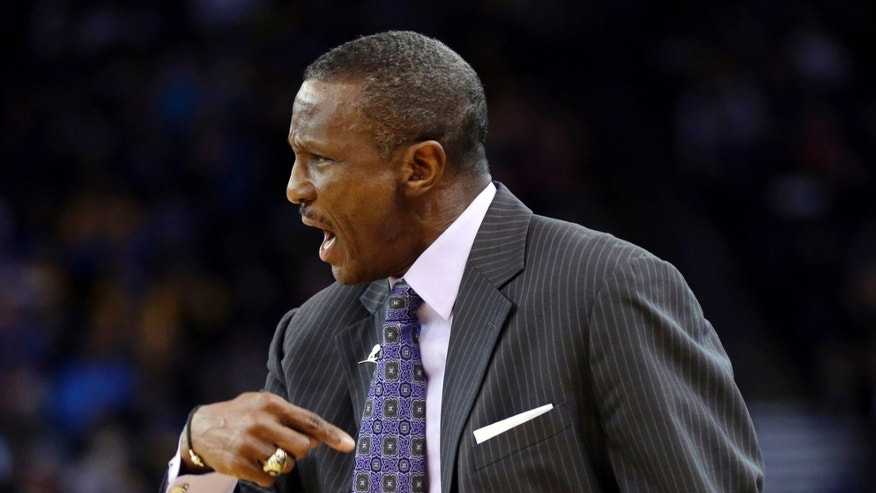 Toronto Raptors head coach Dwane Casey instructs his team against the Golden State Warriors during the first half of an NBA basketball game on Tuesday, Dec. 3, 2013, in Oakland, Calif. (AP Photo/Marcio Jose Sanchez)