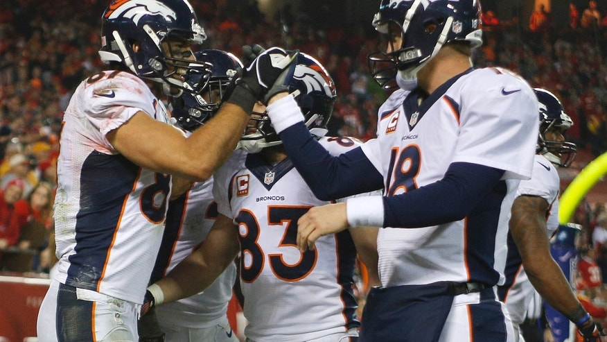 Denver Broncos wide receiver Eric Decker (87) celebrates a touchdown with quarterback Peyton Manning (18) during the second half of an NFL football game against the Kansas City Chiefs, Sunday, Dec. 1, 2013, in Kansas City, Mo. (AP Photo/Ed Zurga)