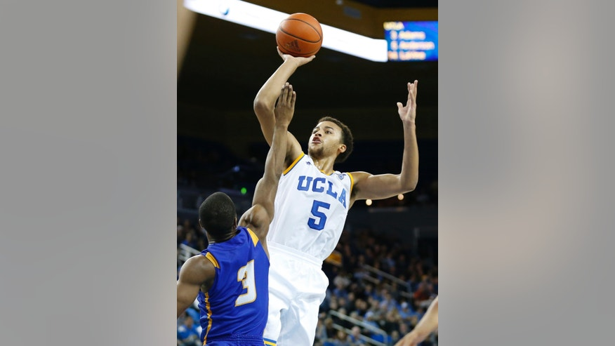 UCLA's Kyle Anderson shoots over UC Santa Barbara's Zalmico Harmon, left, during the second half of an NCAA college basketball game, Tuesday, Dec. 3, 2013, in Los Angeles. UCLA won 89-76. (AP Photo/Danny Moloshok)