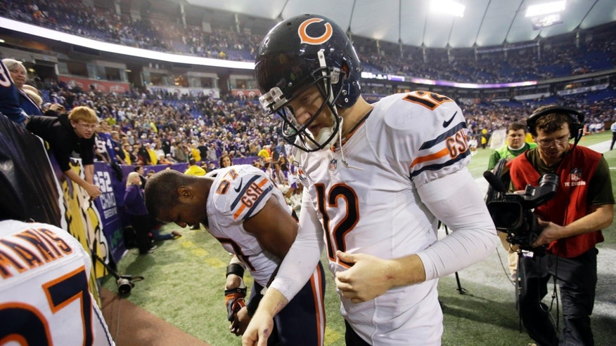 Chicago Bears quarterback Josh McCown (12) walks off the field after an NFL football game against the Minnesota Vikings, Sunday, Dec. 1, 2013, in Minneapolis. The Vikings won 23-20 in overtime. (AP Photo/Jim Mone)