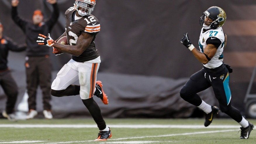 Cleveland Browns wide receiver Josh Gordon (12) outruns Jacksonville Jaguars cornerback Dwayne Gratz (27) on a 95-yard touchdown reception in the fourth quarter of an NFL football game on Sunday, Dec. 1, 2013, in Cleveland. (AP Photo/Tony Dejak)