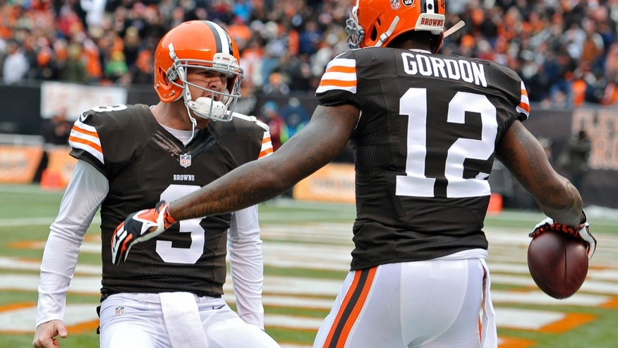 Cleveland Browns quarterback Brandon Weeden (3) celebrates with wide receiver Josh Gordon (12) after they connected on a 21-yard touchdown pass against the Jacksonville Jaguars in the second quarter of an NFL football game on Sunday, Dec. 1, 2013, in Cleveland. (AP Photo/David Richard)