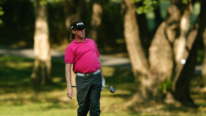 Miguel Angel Jimenez of Spain watches a ball on the 13th hole during the Hong Kong Open golf tournament in Hong Kong Thursday, Dec. 5, 2013.   (AP Photo/Kin Cheung)