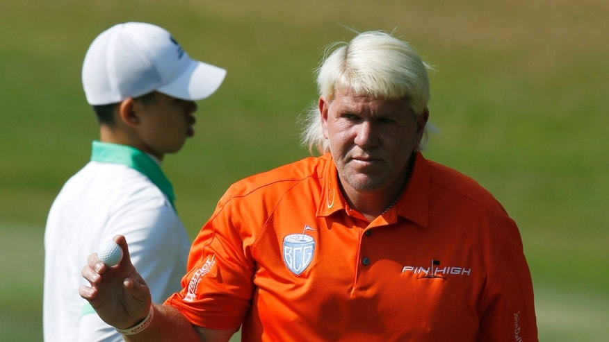 John Daly of the U.S. reacts after hitting a ball on the 10th hole during the Hong Kong Open golf tournament in Hong Kong Thursday, Dec. 5, 2013.   (AP Photo/Kin Cheung)
