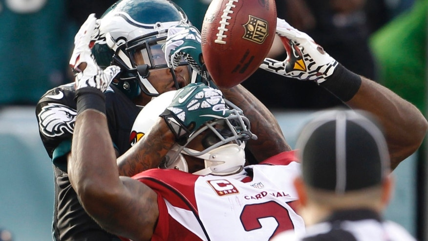 Philadelphia Eagles DeSean Jackson is unable to catch a pass in the end zone as Arizona Cardinals Patrick Peterson defends during an NFL football game on Sunday, Dec. 1, 2013, in Philadelphia.  (AP Photo/The Philadelphia Inquirer, Ron Cortes) PHIX OUT; TV OUT; MAGS OUT; NEWARK OUT