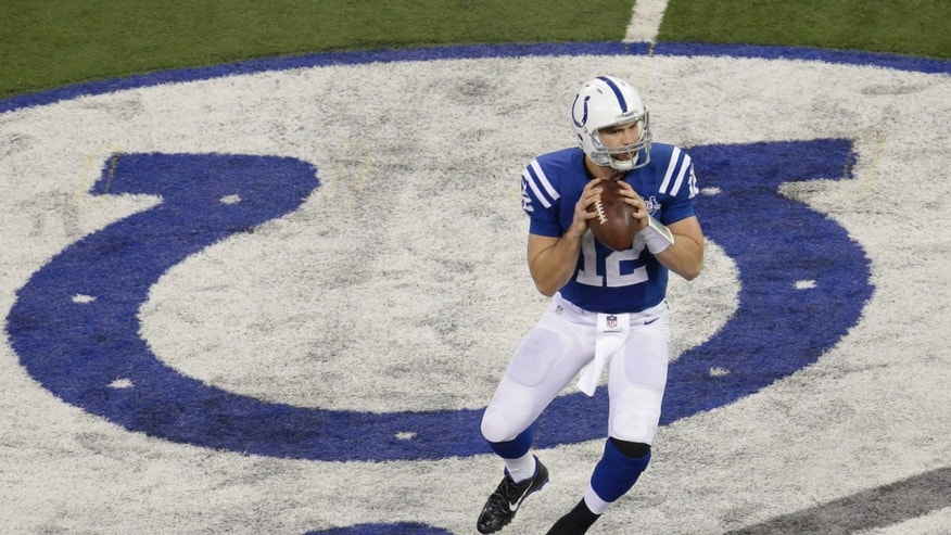 Indianapolis Colts' Andrew Luck (12) looks to throw during the second half of an NFL football game against the Tennessee Titans on Sunday, Dec. 1, 2013, in Indianapolis. (AP Photo/AJ Mast)