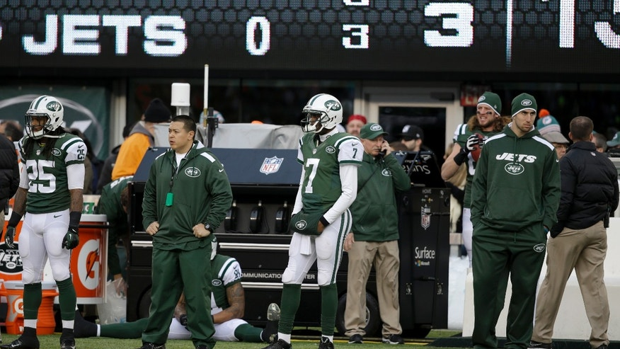 New York Jets quarterback Geno Smith (7) looks on from the sideline after being pulled during the second half of an NFL football game against the Miami Dolphins, Sunday, Dec. 1, 2013, in East Rutherford, N.J. (AP Photo/Seth Wenig)