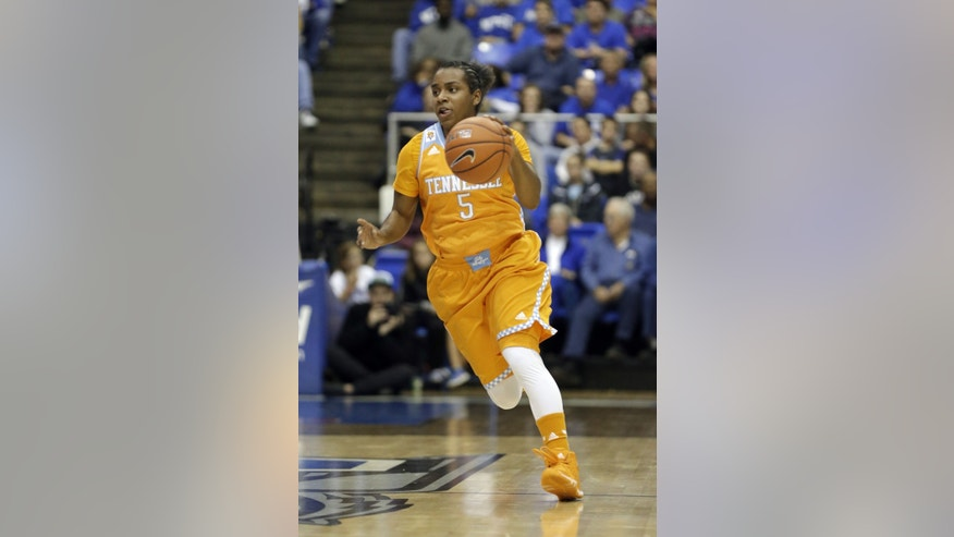 In this Nov. 8, 2013 photo, Tennessee guard Ariel Massengale plays against Middle Tennessee in an NCAA college basketball game in Murfreesboro, Tenn. After an up-and-down first two years at Tennessee, guard Ariel Massengale is delivering a breakthrough junior season for the third-ranked Lady Vols. (AP Photo/Mark Humphrey)