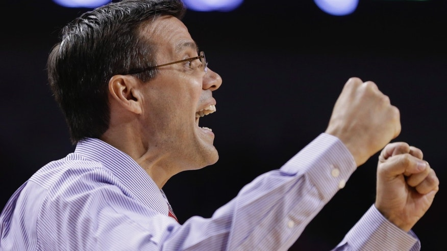 Nebraska coach Tim Miles yells instructions in the second half of an NCAA college basketball game against Miami in Lincoln, Neb., Wednesday, Dec. 4, 2013. Nebraska won 60-49. (AP Photo/Nati Harnik)