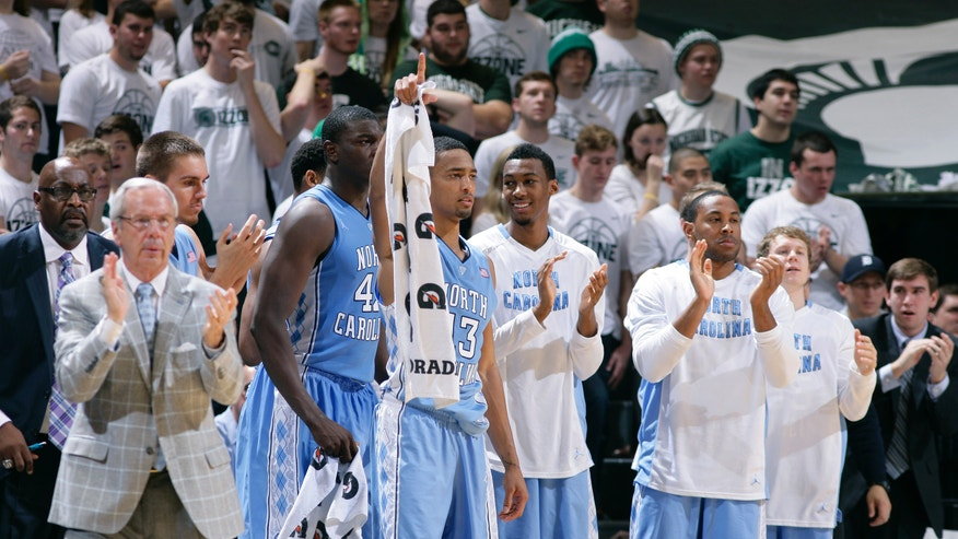 The North Carolina bench celebrates late in the game during the second half of an NCAA college basketball game against Michigan State, Wednesday, Dec. 4, 2013, in East Lansing, Mich. North Carolina won 79-65. (AP Photo/Al Goldis)