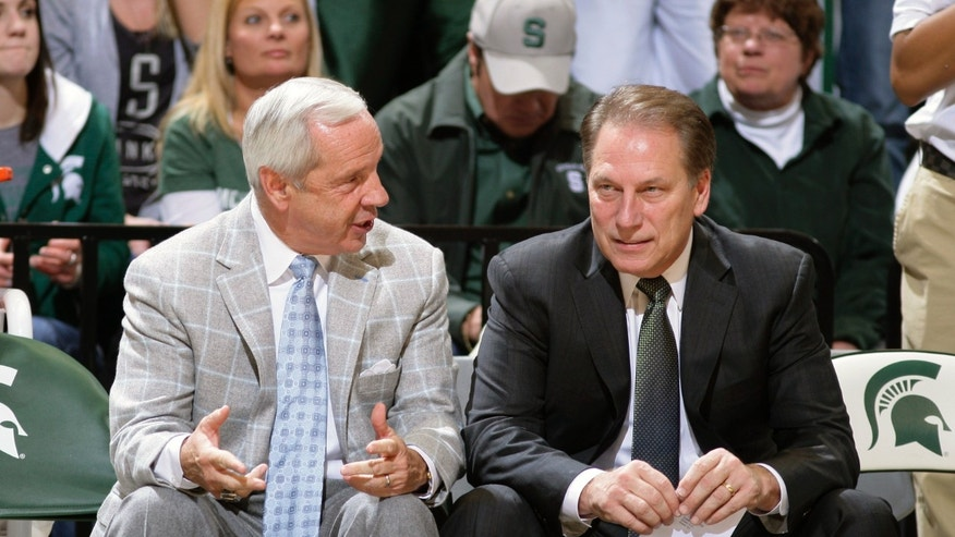 North Carolina coach Roy Williams, left, and Michigan State coach Tom Izzo talk before their NCAA college basketball game, Wednesday, Dec. 4, 2013, in East Lansing, Mich. (AP Photo/Al Goldis)