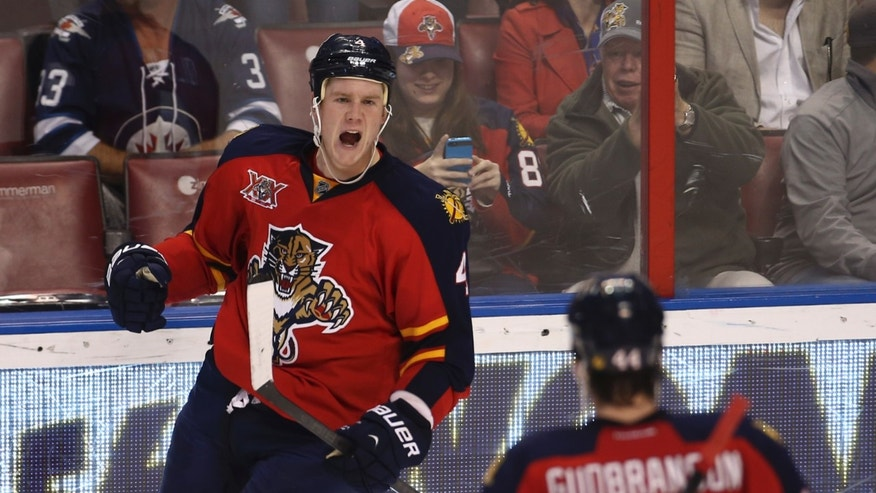 Florida Panthers' Dylan Olsen (4) celebrates with Erik Gudbranson (44) after he scored a goal against the Winnipeg Jets during the second period of a NHL hockey game in Sunrise, Fla., Thursday, Dec. 5, 2013. (AP Photo/J Pat Carter)