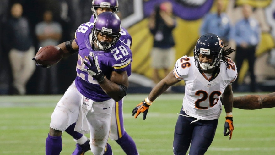 Minnesota Vikings running back Adrian Peterson (28) runs from Chicago Bears cornerback Tim Jennings during overtime of an NFL football game on Sunday, Dec. 1, 2013, in Minneapolis. The Vikings won 23-20. (AP Photo/Ann Heisenfelt)