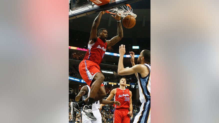 Los Angeles Clippers center DeAndre Jordan (6) dunks the ball over Memphis Grizzlies forward Tayshaun Prince, right, in the first half of an NBA basketball game on Thursday, Dec. 5, 2013, in Memphis, Tenn. (AP Photo/Lance Murphey)