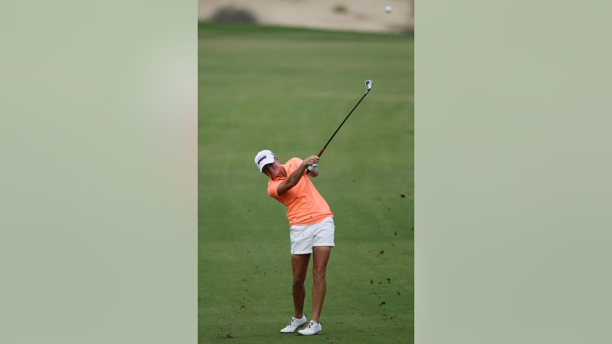 Stacy Lewis of the U.S. plays a ball on the 14th hole during the 2nd round of Dubai Ladies Masters golf tournament in Dubai, United Arab Emirates, Thursday, Dec. 5, 2013. (AP Photo/Kamran Jebreili)