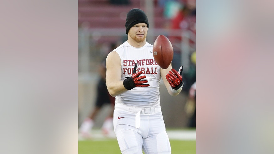 In this photo taken on Nov. 7, 2013, Stanford linebacker Trent Murphy warms up before an NCAA college football game against Oregon in Stanford, Calif. The toughness Murphy plays with can be traced to just a few miles away from where the outside linebacker will lead Stanford against Arizona State in the Pac-12 championship game Saturday night. His upbringing featured steer wrestling, self-defense lessons and a large family of large people, including his father, a 6-foot-7, 290-pound contract plumber. (AP Photo/Jeff Chiu)
