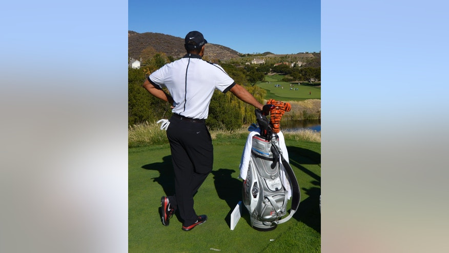 Tiger Woods waits to hit on the 13th hole during the pro-am portion of the Northwestern Mutual World Challenge golf tournament at Sherwood Country Club, Wednesday, Dec. 4, 2013, in Thousand Oaks, Calif. (AP Photo/Mark J. Terrill)