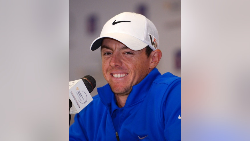 Rory Mcllroy, of Northern Ireland, smiles during a news conference following the pro-am portion of the Northwestern Mutual World Challenge, Wednesday, Dec. 4, 2013, in Thousand Oaks, Calif. (AP Photo/Mark J. Terrill)
