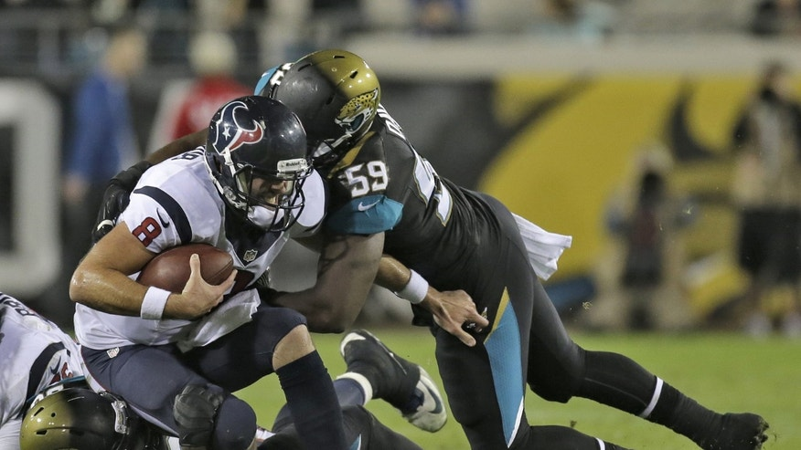 Houston Texans quarterback Matt Schaub (8) is sacked by Jacksonville Jaguars defensive end Ryan Davis (59) during the fourth quarter of an NFL football game Thursday, Dec. 5, 2013, in Jacksonville, Fla. (AP Photo/Chris O'Meara)