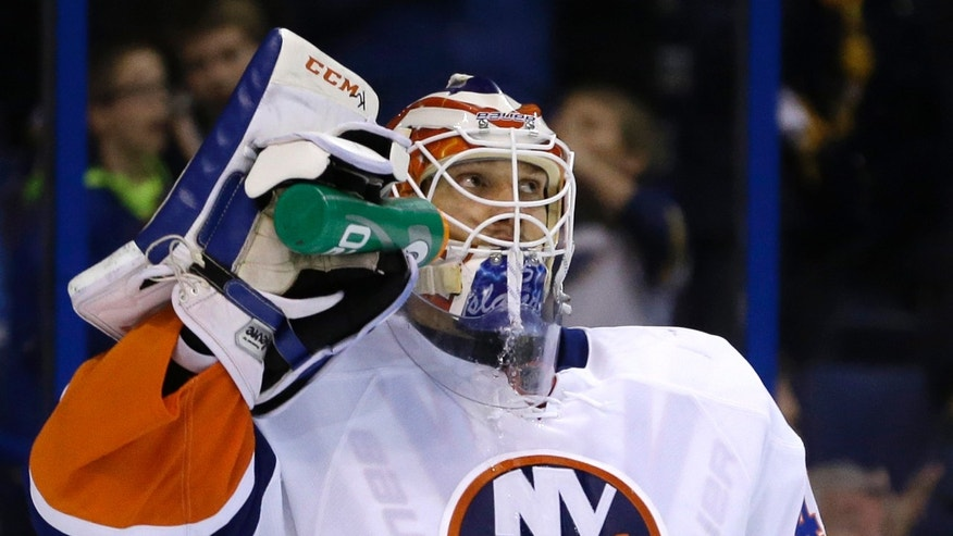 New York Islanders goalie Anders Nilsson, of Sweden, looks toward the scoreboard after giving up a goal to St. Louis Blues' David Backes during the second period of an NHL hockey game Thursday, Dec. 5, 2013, in St. Louis. (AP Photo/Jeff Roberson)