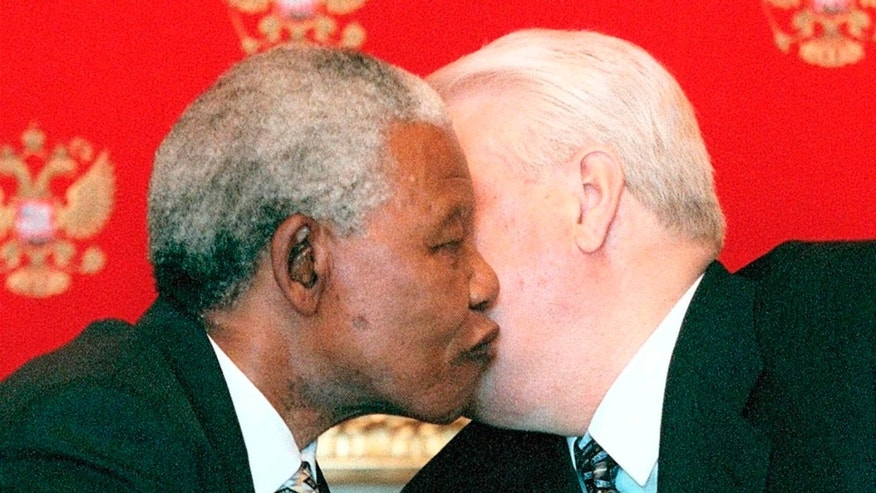 CAPTION CORRECTS THE DATE OF DEATH  FILE - In this Thursday, April 29, 1999, file photo,  Russian President Boris Yeltsin, right, and South African President Nelson Mandela, greet each other during a welcoming ceremony at the Kremlin, Russia. Mandela passed away Thursday, Dec. 5, 2013, after a long illness. He was 95. As word of Mandela's death spread, current and former presidents, athletes and entertainers, and people around the world spoke about the life and legacy of the former South African leader. (AP Photo/Mikhail Japaridze, file)