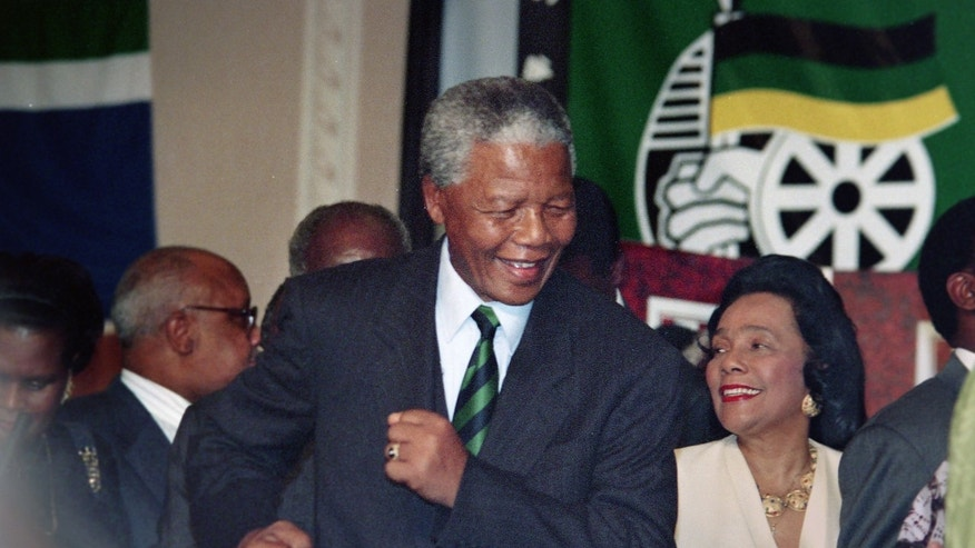 This file photo from 1994 shows Nelson Mandela dancing with Coretta Scott King after hew was elected as South Africa's first black president during a African National Congress victory party held in downtown Johannesburg, South Africa. (AP Photo/The Star Tribune, Jerry Holt, File)