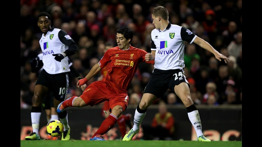 LIVERPOOL, ENGLAND - DECEMBER 4:   Luis Suarez of Liverpool scores his third goal during the Barclays Premier League match between Liverpool and Norwich City at Anfield on December 4, 2013 in Liverpool, England.  (Photo by Jan Kruger/Getty Images)