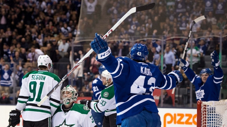 Toronto Maple Leafs center Nazem Kadri (43) celebrates his goal with teammate Phil Kessel, right, as Dallas Stars goaltender Kari Lehtonen and center Tyler Seguin (91) react during the second period of an NHL hockey game, Thursday, Dec. 5, 2013 in Toronto. (AP Photo/The Canadian Press, Frank Gunn)