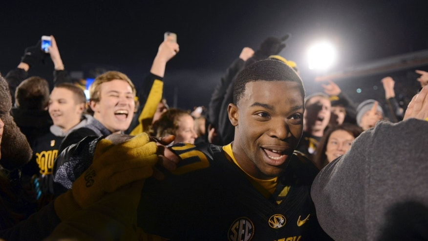 Missouri running back Henry Josey makes his way through the crowd following Missouri's 28-21 victory over Texas A&M in an NCAA college football game on Saturday, Nov. 30, 2013, in Columbia, Mo. (AP Photo/L.G. Patterson)