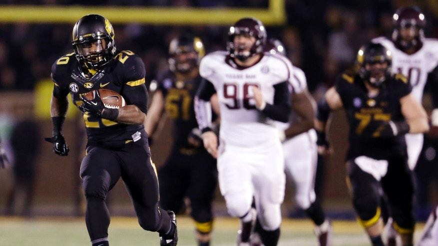 Missouri running back Henry Josey, left, scores on a 57-yard touchdown run during the fourth quarter of an NCAA college football game against Texas A&M on Saturday, Nov. 30, 2013, in Columbia, Mo. (AP Photo/Jeff Roberson)