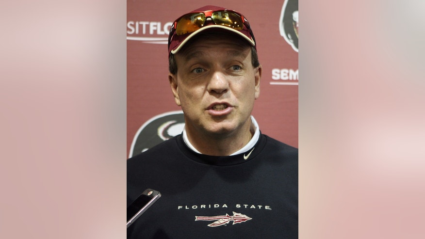 Florida State's head coach Jimbo Fisher speaks about his teams practice as they prepare for the upcoming ACC championship on Thursday, Dec. 5, 2013 in Tallahassee.  Florida State quarterback and Heisman Trophy candidate Jameis Winston will not be charged with sexually assaulting a woman who accused him of raping her(AP Photo/Steve Cannon)