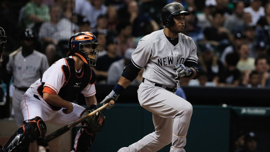 HOUSTON, TX - SEPTEMBER 28:  Robinson Cano #24 of the New York Yankees hits a single in the sixth inning against the Houston Astros at Minute Maid Park on September 28, 2013 in Houston, Texas.  (Photo by Scott Halleran/Getty Images)