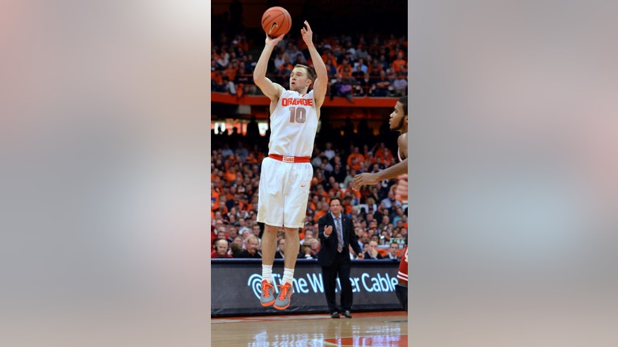 Syracuse's Trevor Cooney takes a shot against Indiana during the second half of an NCAA college basketball game in Syracuse, N.Y., Tuesday, Dec. 3, 2013. Syracuse won 69-52. (AP Photo/Kevin Rivoli)