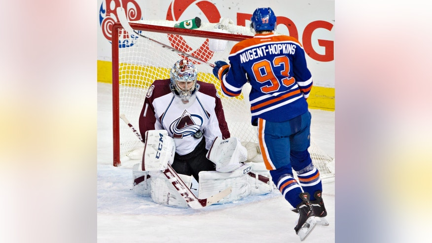 Colorado Avalanche goalie Semyon Varlamov (1) makes the save on Edmonton Oilers' Ryan Nugent-Hopkins (93) during second-period NHL hockey game action in Edmonton, Alberta, Thursday, Dec. 5, 2013. (AP Photo/The Canadian Press, Jason Franson)