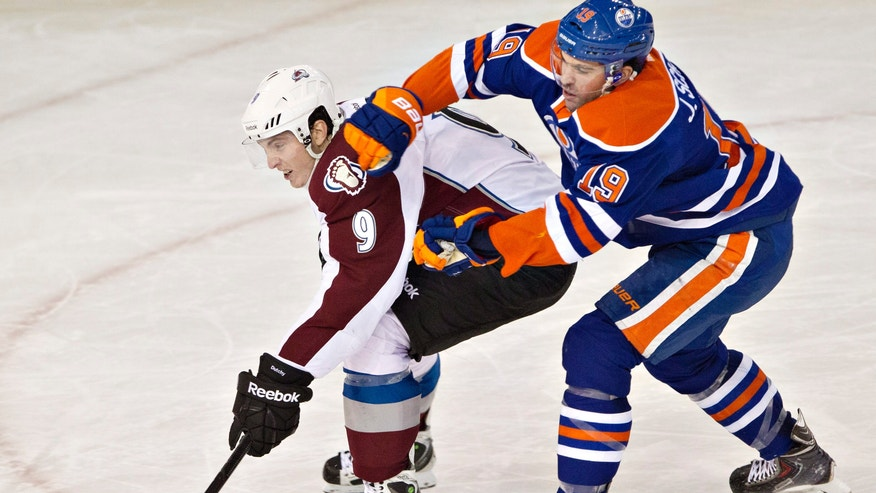 Colorado Avalanche's Matt Duchene (9) is chased down by Edmonton Oilers' Justin Schultz (19) during second-period NHL hockey game action in Edmonton, Alberta, Thursday, Dec. 5, 2013. (AP Photo/The Canadian Press, Jason Franson)