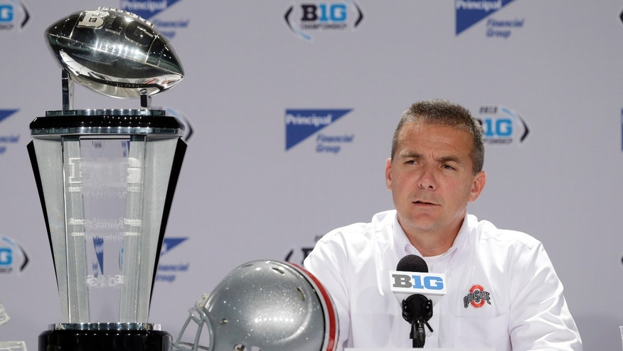 Ohio State head coach Urban Meyer responds to a question during a news conference for the Big Ten Conference championship NCAA college football game Friday, Dec. 6, 2013, in Indianapolis. Ohio State will play Michigan State, Saturday for the championship. (AP Photo/Darron Cummings)