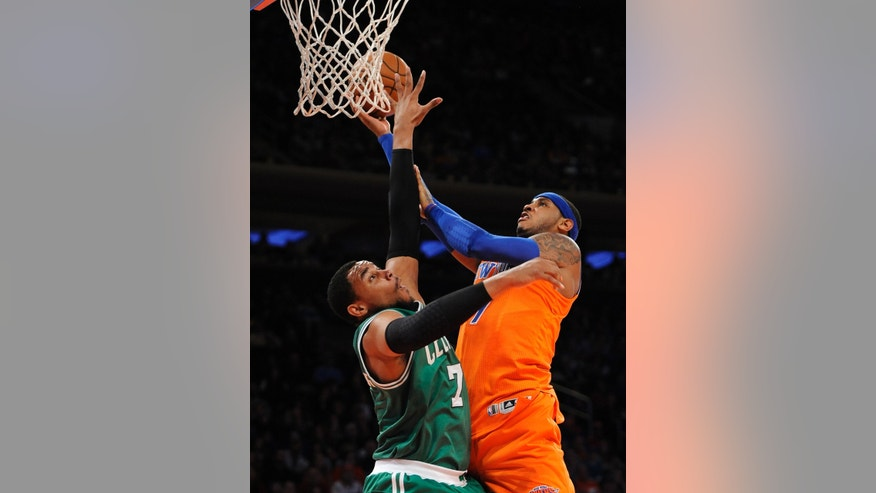 Boston Celtics' Jared Sullinger (7) blocks the shot of New York Knicks' Carmelo Anthony (7) during the first half an NBA basketball game on Sunday, Dec. 8, 2013, in New York. (AP Photo/Kathy Kmonicek)