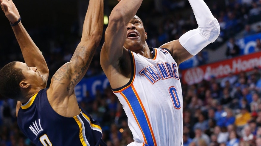 Oklahoma City Thunder guard Russell Westbrook (0) shoots in front of Indiana Pacers guard George Hill (3) in the second quarter of an NBA basketball game in Oklahoma City, Sunday, Dec. 8, 2013. (AP Photo/Sue Ogrocki)