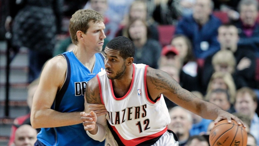 Portland Trail Blazers forward LaMarcus Aldridge, right, works the ball in on Dallas Mavericks forward Dirk Nowitzki, from Germany, during the first half of an NBA basketball game in Portland, Ore., Saturday, Dec. 7, 2013. (AP Photo/Don Ryan)
