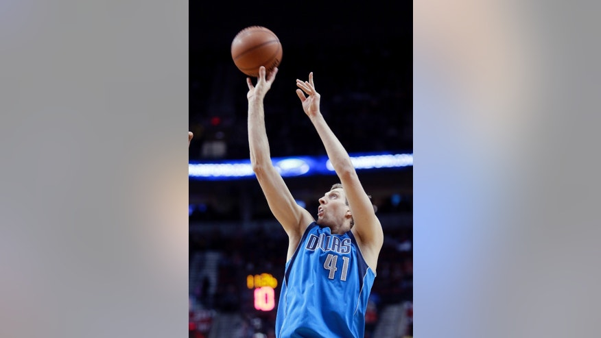 Dallas Mavericks forward Dirk Nowitzki shoots a three point shot during the first half of an NBA basketball game against the Portland Trail Blazers in Portland, Ore., Saturday, Dec. 7, 2013. (AP Photo/Don Ryan)